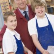 Schoolboys and teacher in woodwork class - Stock Photo
