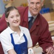 Schoolgirl and teacher in woodwork class — Stock Photo #4761420