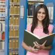Stock Photo: University student in library