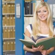 University student studying in library — Foto Stock