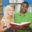 Stock Photo: Two university students working in library