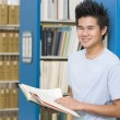 University student working in library — Stock Photo #4761437