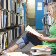 University student working in library — Foto de stock #4761470