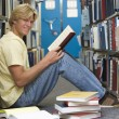 University student working in library — Stock Photo #4761475