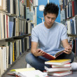 Stock Photo: University student working in library