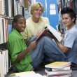 Group of university students working in library — Stock Photo #4761492