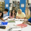Group of university students working in library — Stock Photo