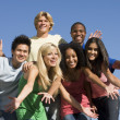 Stock Photo: Group of young friends outside