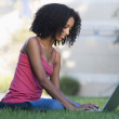 University student using laptop outside — Stock Photo