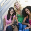 Group of female university students on steps — Stockfoto