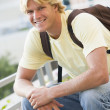 Male student sitting outside — Stock Photo #4761586