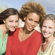 Group of three female friends at beach — Stock Photo