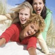 Three female friends having fun at beach — Stock Photo