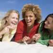 Stock Photo: Three friends having fun at beach