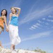 Two young women relaxing at beach — Stock Photo #4761649