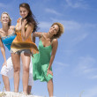 Three female friends relaxing at beach — Stock Photo #4761661