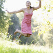 Young woman in summer meadow — Stock Photo #4761684
