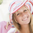 Young woman wearing straw hat — Stock Photo
