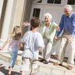 Stock Photo: Grandparents welcoming grandchildren