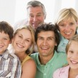 Family indoors together smiling — Stock Photo #4763497