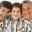 Grandfather with son and grandson smiling — Stock Photo
