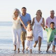 Extended family walking on beach - Stock Photo