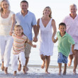 Extended family walking on beach — Stock Photo