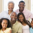 Extended family sitting on sofa — Stock Photo