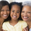 Grandmother with adult daughter and grandchild - Stockfoto