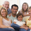 Extended family in living room smiling — Stock Photo #4763592