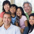 Extended family in living room smiling — Stock Photo #4763611
