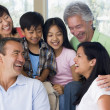 Extended family in living room smiling — Foto Stock