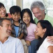 Extended family in living room smiling — Stock Photo #4763612