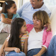Stock Photo: Grandparents talking with grandchildren