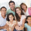 Extended family in living room smiling — Stock Photo