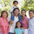 Extended family standing outdoors smiling — Stockfoto
