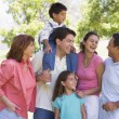 Extended family at the park smiling — Stock Photo