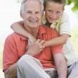 Stock Photo: Grandfather and grandson smiling