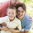 Grandfather with adult son and grandchild in park — Stock Photo #4763696
