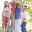 Grandparents laughing with grandchildren — Stock Photo #4763713