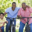 Grandfather grandson and son bike riding — Stock Photo