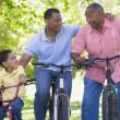 Royalty-Free Stock Photo: Grandfather grandson and son bike riding