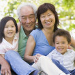 Grandparents laughing with grandchildren — Stock Photo #4763763