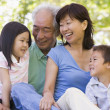 Stock Photo: Grandparents laughing with grandchildren