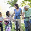 Zdjęcie stockowe: Grandparents bike riding with grandchildren