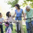 Stock Photo: Grandparents bike riding with grandchildren