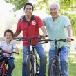 Stock Photo: Grandfather son and grandson bike riding
