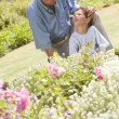 Grandfather and grandson working in the garden — Stock Photo