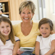 Stock Photo: Grandmother reading with grandchildren