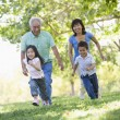 Grandparents running with grandchildren — Foto Stock #4763848